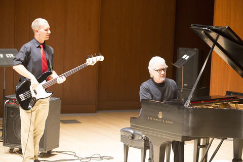 Jack and current student playing piano and bass guitar