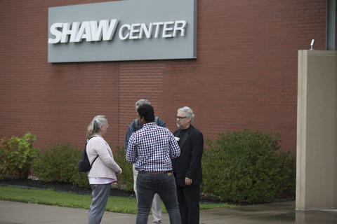 Alumni standing outside the Shaw Center