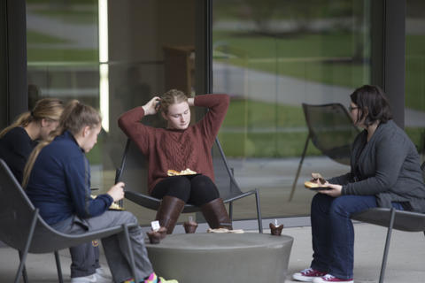 Current students sitting outside of the Shaw Center