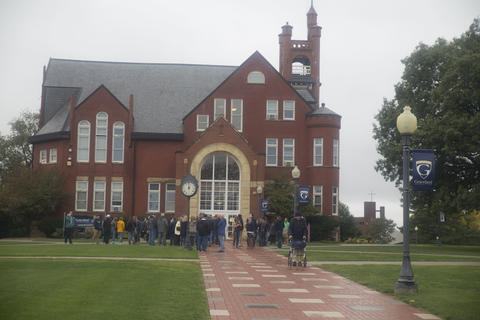 Alumni in front of the Higdon Administration Building