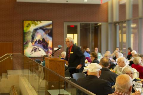 Paul Davis addressing the audience of alumni.