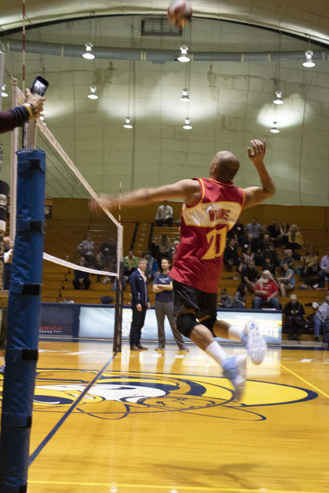 Holding nothing back, GU alumni shows he can keep up as he fiercely spikes down the ball.