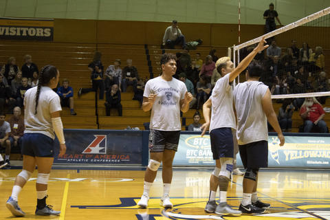 A prompt cool down at the annual alumni vs student men's volleyball game.
