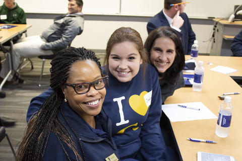 Admission counselor Keeyon Johnson with two future Graceland University students.