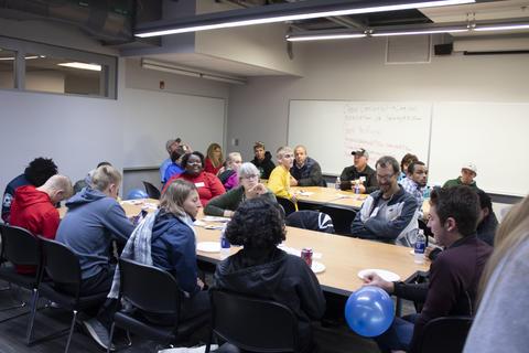 Parents listen for additional Graceland University activities.