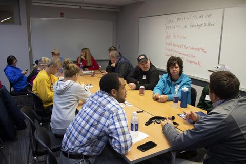 Coach talks with parents about Graceland University athletics.