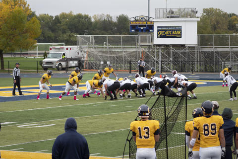 Football team setting up a play on the field