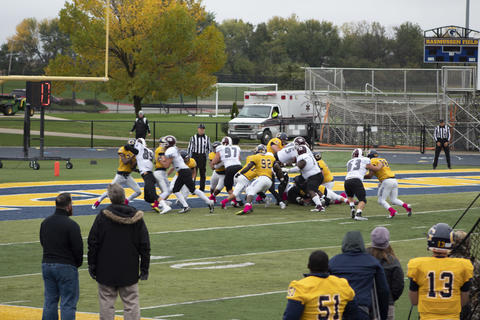 Football team during a play on the field