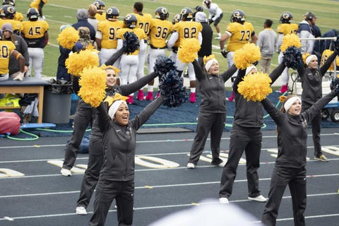 Cheer squad performing a cheer at the game