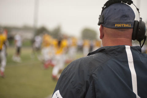 Coach on the sideline with a headset
