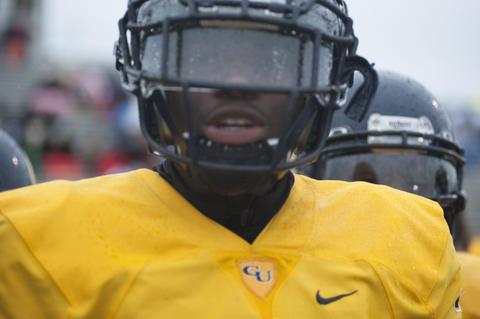 Football player looking at the camera up close