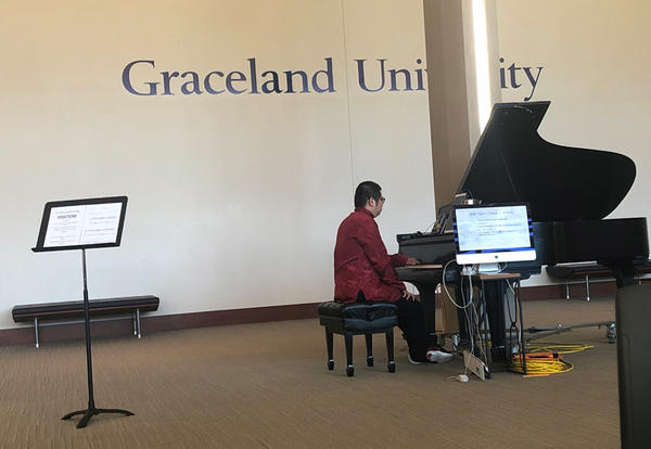 """Dr. Yimmy plays """"Vexation"""" on the piano in the Shaw Lobby"""