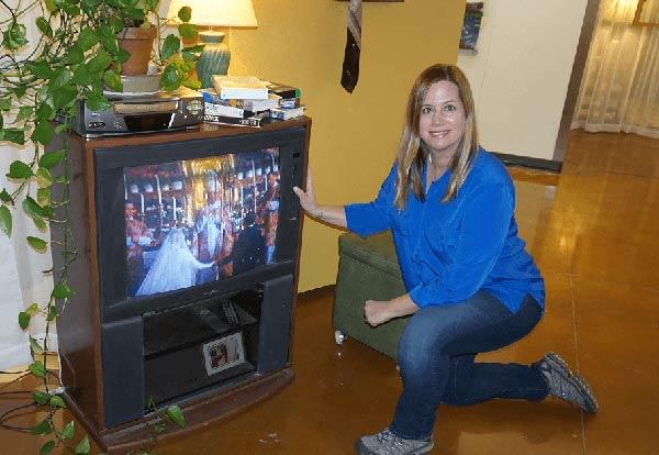 Julia Franklin in front of the 1970s TV at her art exhibit