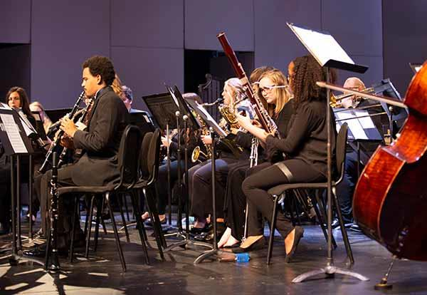 Band students on stage in concert