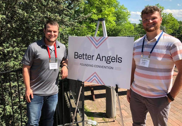 Christian Sarabia and Anthony Ginger pose with a Better Angels sign