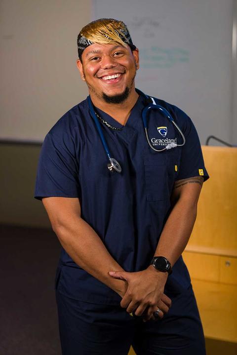 Male nursing student in navy nursing scrubs