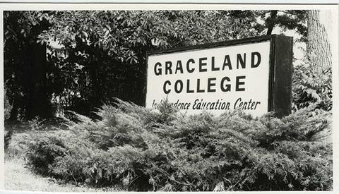 Black and white photo of sign on campus: Graceland College Independence Education Center