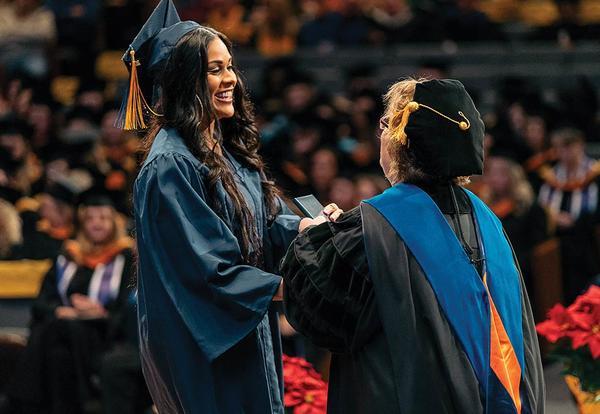Graceland President Pat Draves congratulates a graduate