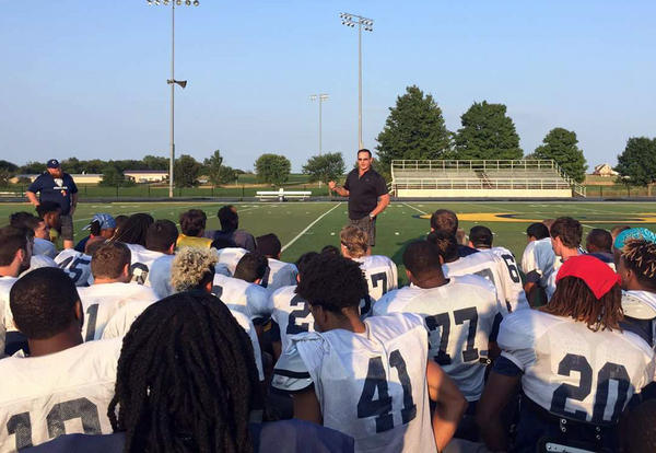 Jeff Criswell speaks to the Graceland football team in 2017