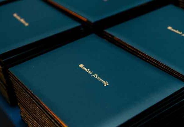 stacks of Graceland University diplomas