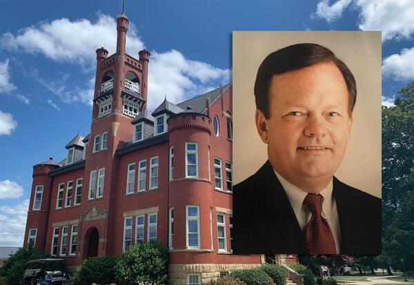 Higdon Administration Building with photo of Joe Hanna
