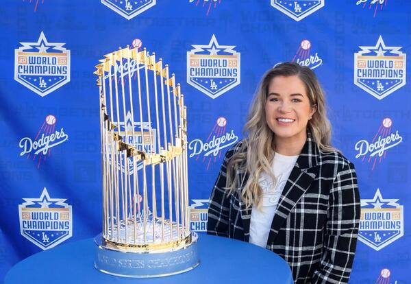 Graceland Graduate Zoe Harmon poses with the World Series trophy
