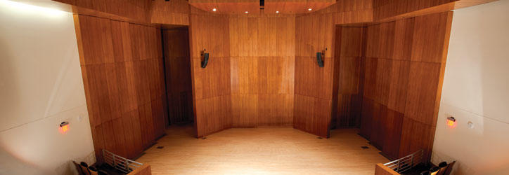 The acoustically perfect stage in Carol Hall with solid rich wood panels as the backdrop, floor to ceiling.