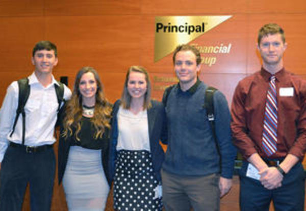 Male and female students from the Social Media Marketing class pose at Principal Group during the Voice of the Young Consumer Business Challenge