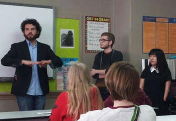 Professor Tim Robbins and Graceland student Matt Moore address a high school English class