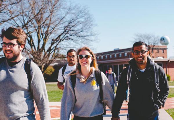 Male and female students walking the Graceland University campus in Lamoni