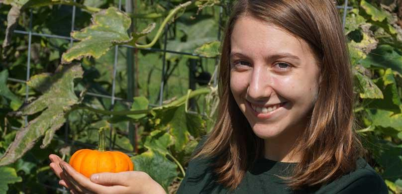 Female holding pumpkin