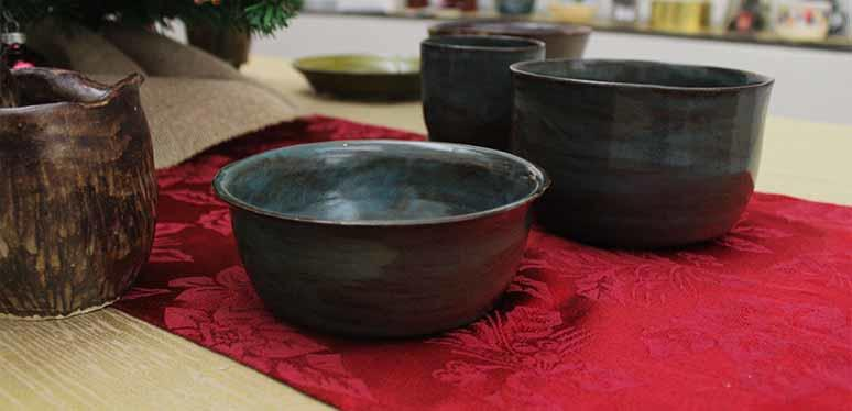 Handmade pottery on display in a gallery