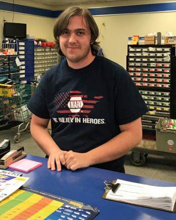 A Hunterdon Prep student working as an intern - behind the counter at an automotive shop.