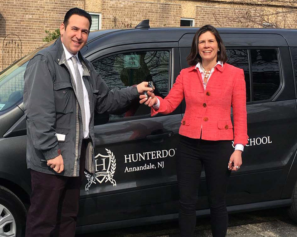 Hope Atkinson, Assistant Director, takes the keys to a new van from Peter Puglia, Flemington Car & Truck Country.