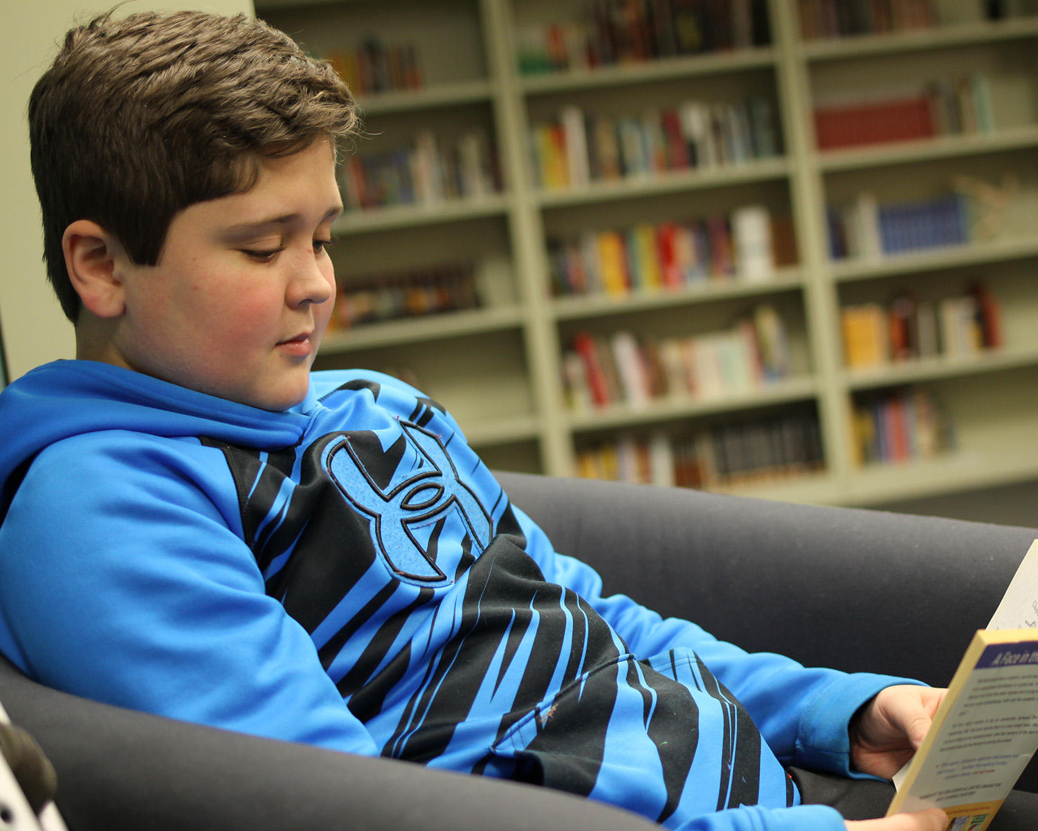 A Hunterdon Prep student reads a book in the library