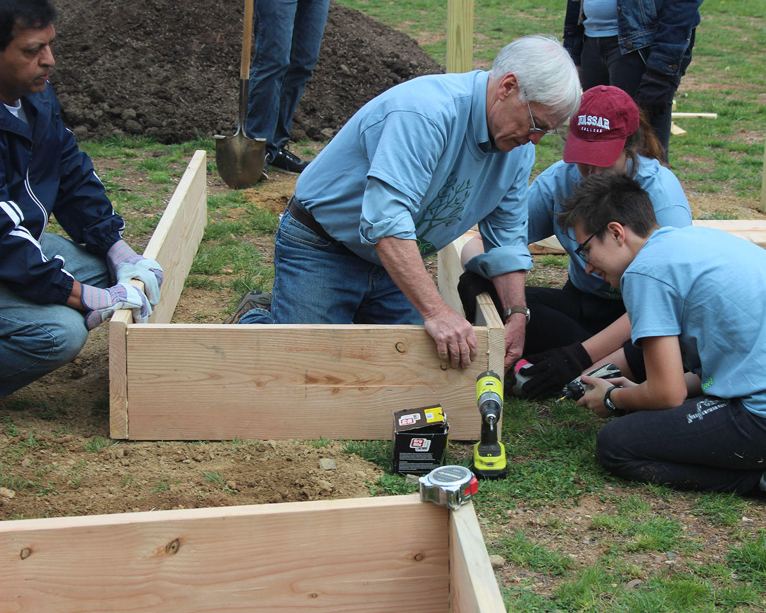 Students and volunteers building raised beds for the community garden