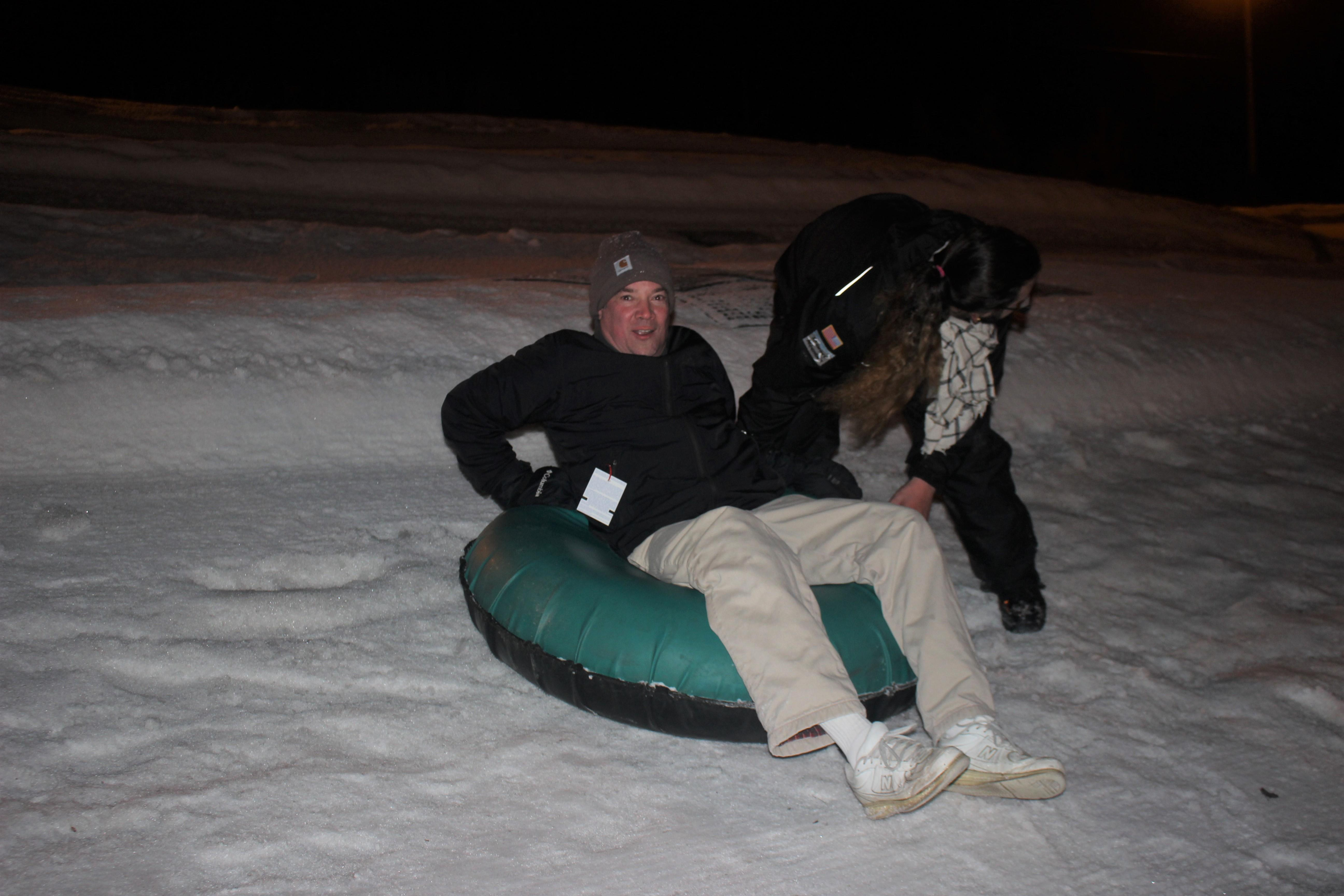 Staff member on a snow tube