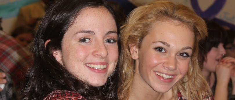 Close up photograph of two smiling Hunterdon Prep students