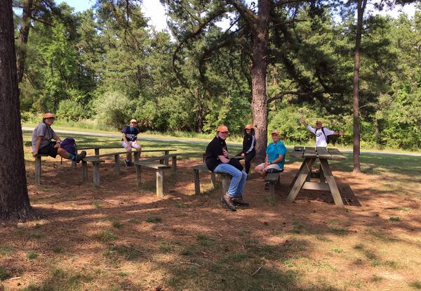 photograph of students at picnic tables at a park