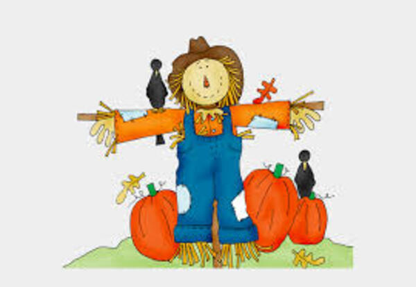 picture of scarecrow, crows and pumpkins