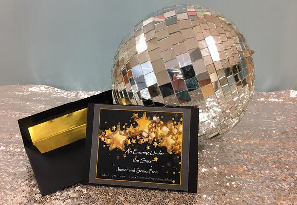 Picture of a disco ball with a prom invitation