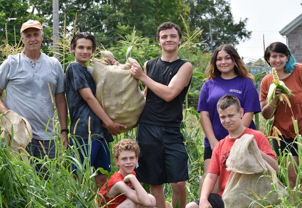 students picking corn