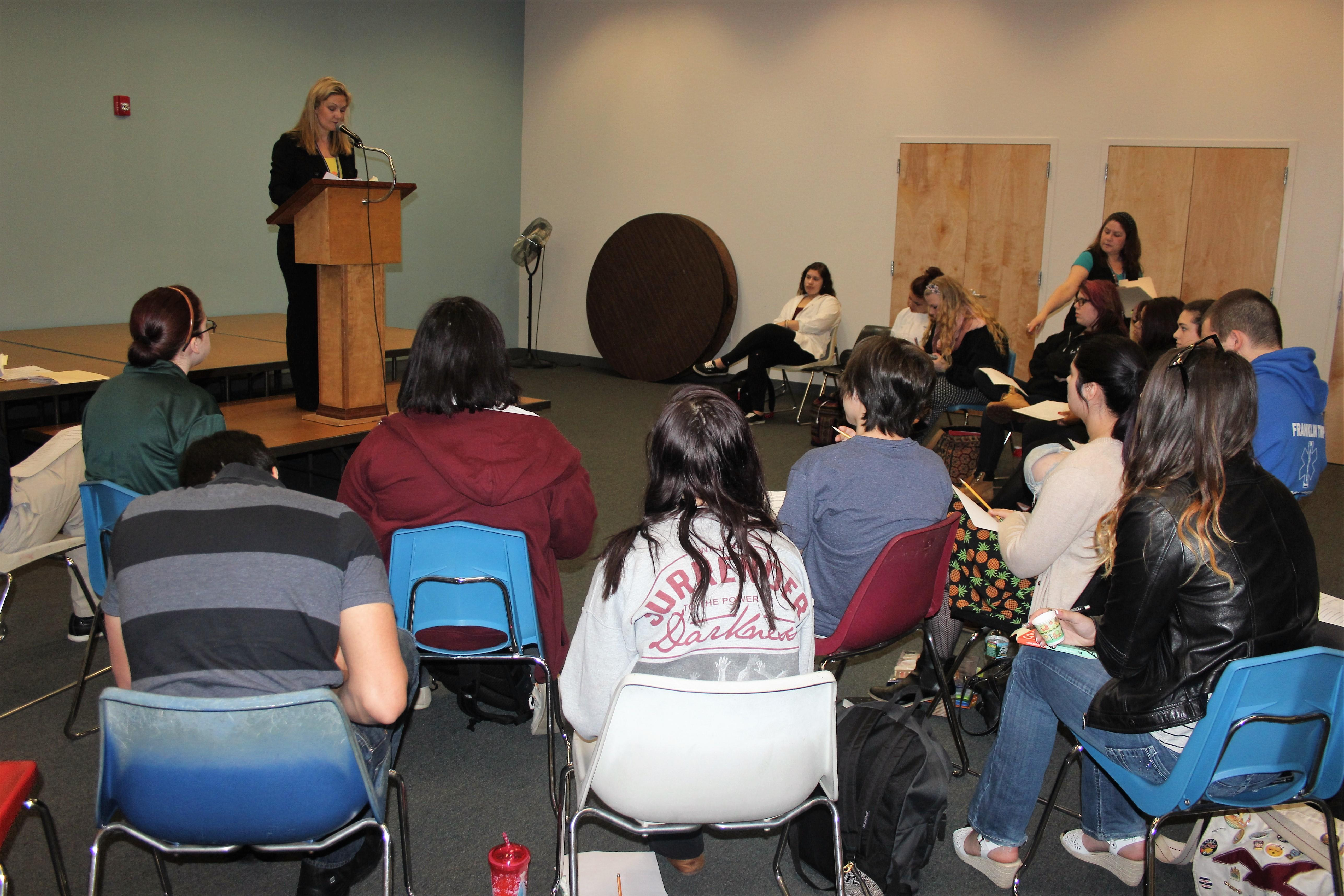 Students listening to a poetry reading by English Instructor, Lorrieann Geyer