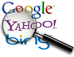 A magnifying glass on sitting on top of Google, Yahoo, and bing logo's. This is a stock photograph from the internet.
