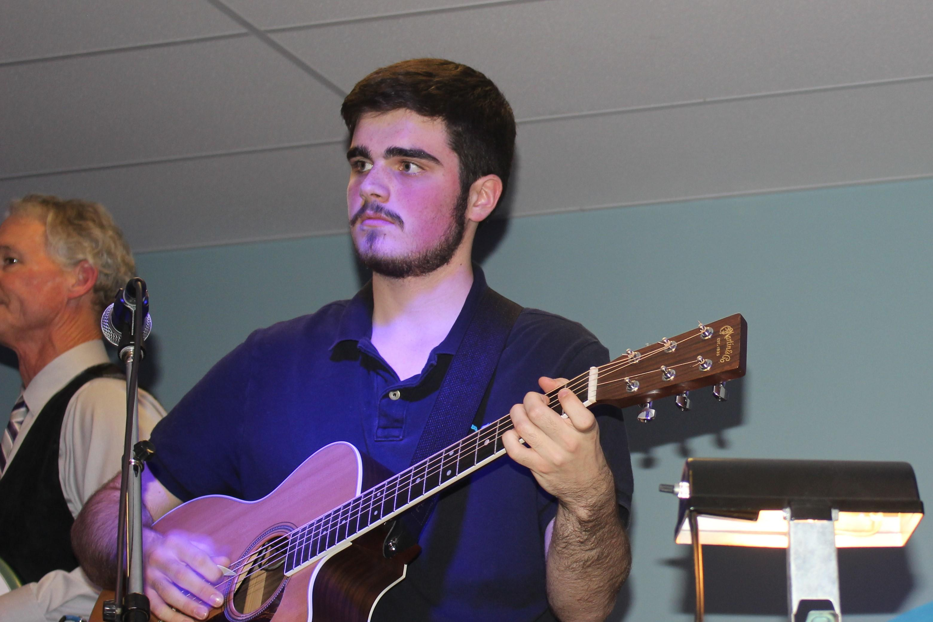 A student playing the guitar