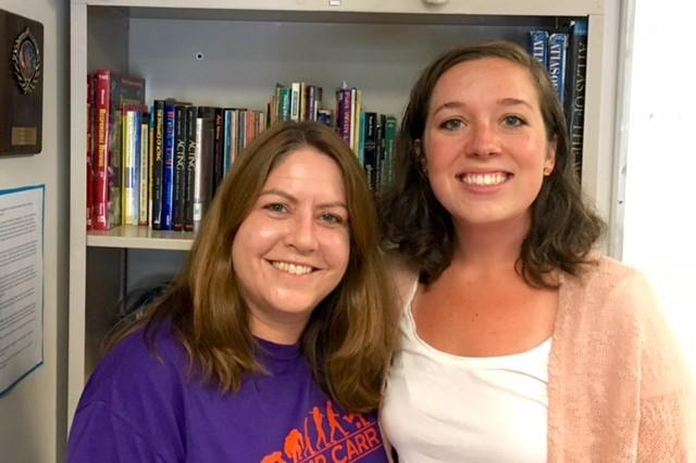 Middle School Instructor, Laura Gurry and Instructional Aide, Molly Alderman-Person in a middle school classroom.