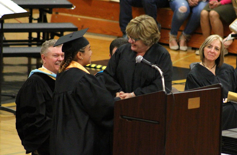 2017 EPHS graduation — Class President Diamond Lopez presents the class gift to Board President Mary Bruscato