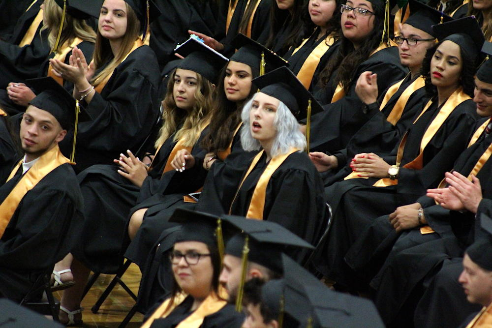 2017 EPHS graduation — students look on as classmates begin walking to receive their diplomas