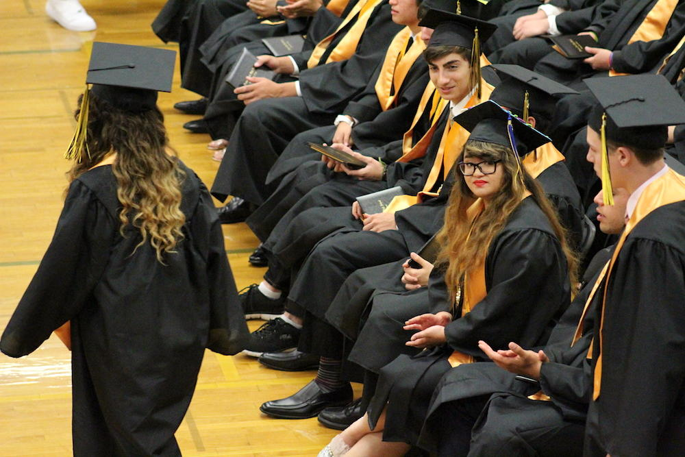2017 EPHS graduation — Kassandra Babelonia looks on as her classmates approach the dais for their diplomas