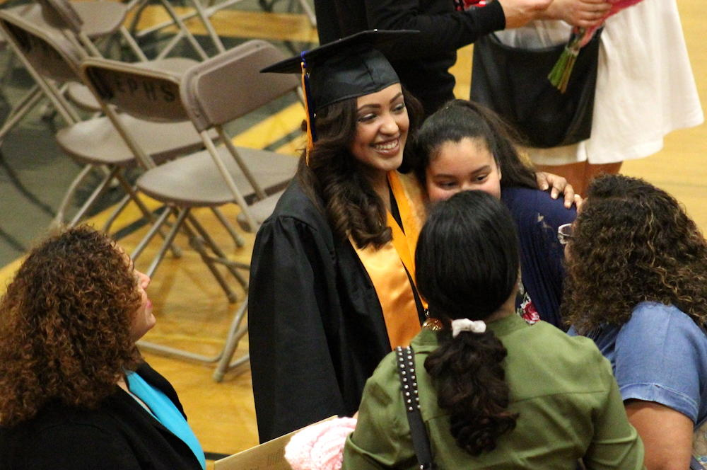 2017 EPHS graduation — student celebrates with her family after the ceremony
